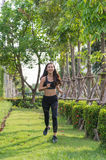 Sport woman exercise by jogging at the park, she run on the grass. Royalty Free Stock Photos