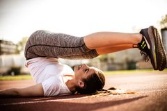 Sport woman . Exercise outside. Stock Images