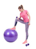Sport woman exercise with a pilates ball and dumbbells Stock Images