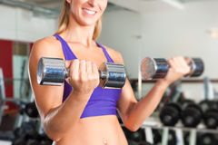Sport - woman is exercising with barbell in gym Stock Photo