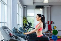 Sport woman exercising gym, fitness center Royalty Free Stock Image