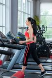 Sport woman exercising gym, fitness center Stock Photo