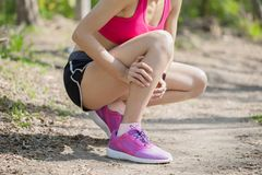 Sport woman with calf strain Royalty Free Stock Images