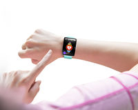 Sport woman finger pointing health sensor smart watch hand weari Royalty Free Stock Photography