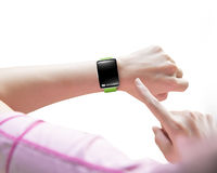 Sport woman finger pointing smartwatch blank black glass bent to Stock Photos