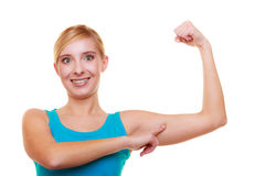 Sport woman fitness girl showing her muscles. Power and energy. Isolated. Royalty Free Stock Photos