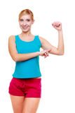 Sport woman fitness girl showing her muscles. Power and energy. Isolated. Royalty Free Stock Images