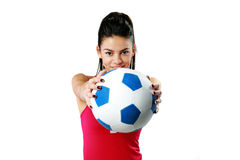 Sport woman giving you a soccer ball Royalty Free Stock Photos