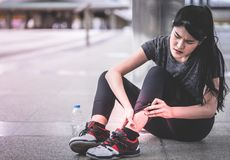 Sport woman having an injury on her ankle foot. Sport woman is having an injury on her ankle foot Stock Image