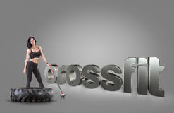 Sport woman holding a hammer on the background Motivational fitness phrases. Sporty woman holding black dumbbells on black background Royalty Free Stock Photography