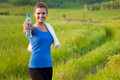 Sport woman holding water royalty free stock image