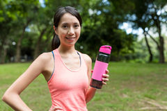 Sport woman holding water bottle in the park Royalty Free Stock Images
