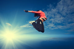 Sport woman jumping and fly over sky and sun royalty free stock images