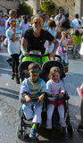 Sport woman and kids in a stroller royalty free stock photography