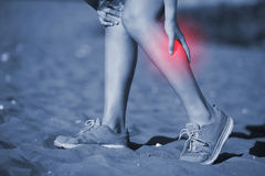 Sport woman knee injury Royalty Free Stock Photography