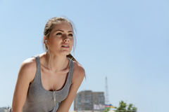 Sport woman listening to music while exercising Royalty Free Stock Images