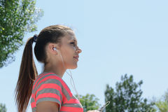 Sport woman listening to music on the phone Stock Photos