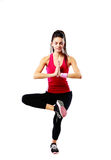 Sport woman meditated on one leg Stock Photo