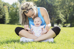 Sport woman outside baby Stock Photos