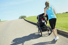 Sport woman outside baby Stock Photo