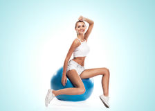 Sport woman in perfect shape . Concept - healthy lifestyles Stock Photography