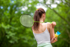 Sport woman playing badminton Royalty Free Stock Photo