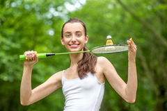 Sport woman playing badminton Stock Photos