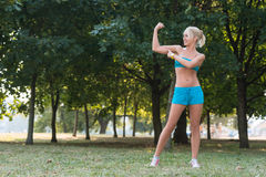 Sport woman posing in the park Royalty Free Stock Photo