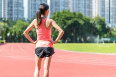 Sport woman ready for running in track stadium Royalty Free Stock Photos