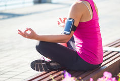 Sport woman relax outside after training in city quay Royalty Free Stock Photography