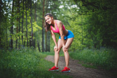 The sport woman relaxing after jogging Royalty Free Stock Image