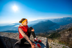 Sport woman resting on the mountain Royalty Free Stock Photography