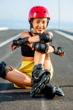 Sport woman with rollers on the highway Royalty Free Stock Photography