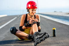 Sport woman with rollers on the highway Royalty Free Stock Images