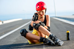 Sport woman with rollers on the highway Stock Photos