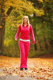 Sport Woman running in autumn forest Royalty Free Stock Image