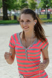 Sport woman running and listening to music Royalty Free Stock Photo