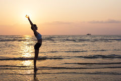 Sport woman silhouette on the beach Stock Image
