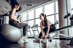 Sport woman sitting and resting after workout or exercise in fitness gym. Sport women sitting and resting after workout or exercise in fitness gym with bottle royalty free stock images