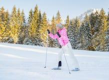Sport woman on ski in winter resort Royalty Free Stock Photos