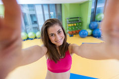 Sport woman smile at camera self picture at gym, young girl picture herself exercising fitness center Stock Photos