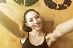 Sport woman smile at camera self picture at gym, young girl picture herself exercising fitness center Royalty Free Stock Photography