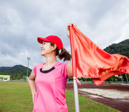 Sport woman smiling and flag Stock Photos