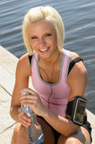 Sport woman smiling relax water sitting pier Royalty Free Stock Photo