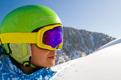 Sport woman in snowy mountains Stock Images