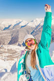 Sport woman in snowy mountains Royalty Free Stock Photos