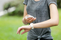 Sport woman with sports watch and cellphone royalty free stock image