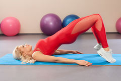 Sport woman in sportswear workout. Athletic girl doing exercise in the fitness room Stock Photography