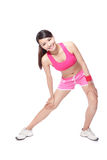 Sport woman stretches her leg Royalty Free Stock Images