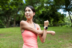 Sport woman stretching arm. Asian young woman Stock Photo